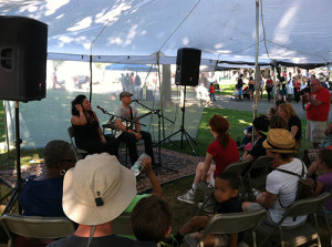 Performers Dwight and Nicole give a talk in the Ed tent before their performance at the 2013 Festival.