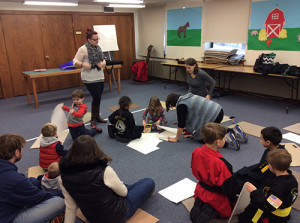 Music teacher Justine Pasquale leads students in a MusicKidz class at Salem Public Library.